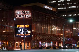 The exterior of The Citadel Theatre at night.