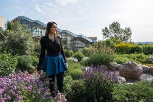 A girl walking through a Medicine Wheel Garden.