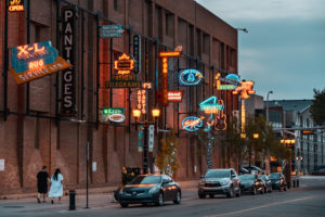 Edmonton A couple walks by the Neon Sign Museum