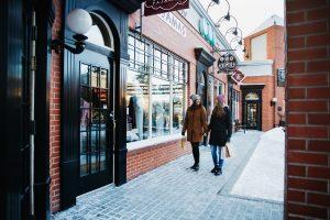 Two women shop on Highstreet off of 124th Street in winter.