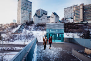 A couple walks along the funicular look-out in winter.