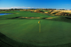 A view of the golf course with a blue sky in the background.