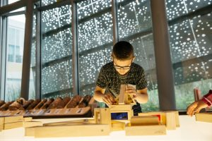 Child playing with building blocks at the Royal Alberta Museum