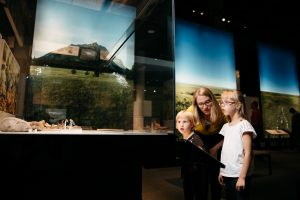 Family looks at an exhibit at the Royal Alberta Museum.