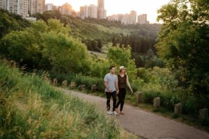 Couple Walking Through River Valley