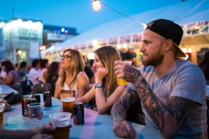 A group of friends hang out at Edmonton Fringe's beer gardens.