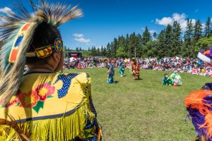 A child and a crowed at the Poundmakers Powwow.