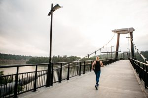 Woman running across bridge