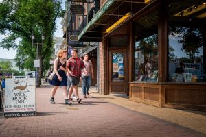 A group of friends explore Whyte Ave.