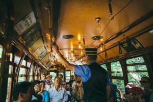 high level streetcar, conductor talking to passengers