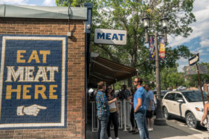 People wait in line outside of Meat.