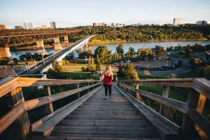A women runs the river valley stairs.