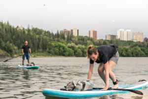 Edmonton River Valley Stand Up Paddleboard Man And Woman cropped
