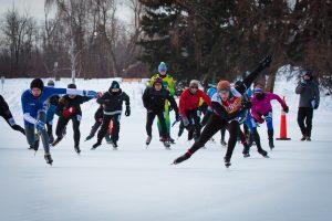 Skaters race along the ice on Hawrelak Park Pond at the Silver Skate Festival.