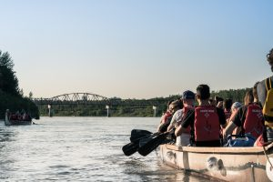 A group canoes down the North Saskatchewan River.