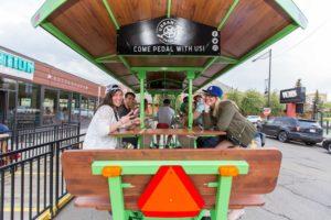 People on the bike with Edmonton Urban Pedal Tours.