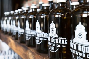 A row of Growlers from Town Square Brewing Co.