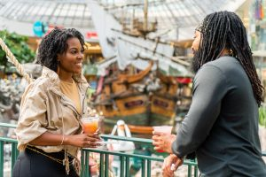 A couple in front of the pirate ship at West Edmonton Mall.