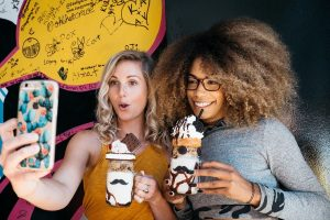 Women taking a selfie with ice cream.
