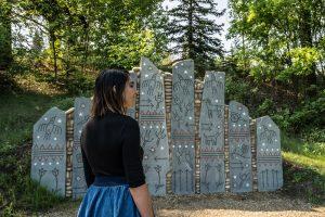 A girl tours the Indigenous Art Park.