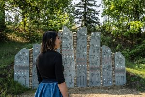 A girl tours the Indigenous Art Park.