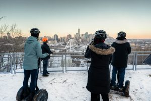 Group segways through Edmonton's river valley and stops to take a picture of the view