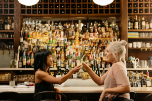 Two women cheers at Bar Clementine.
