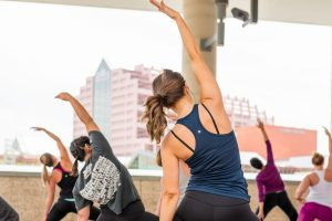 a yoga class takes place on the roof of tix on the square in Edmonton