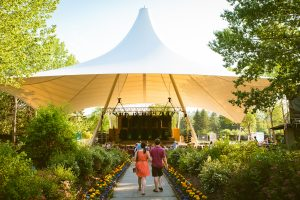 A couple walks up to the tent at the Freewill Shakespeare Festival