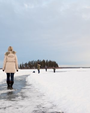 two girls walking through the snow at Elk Island National Park