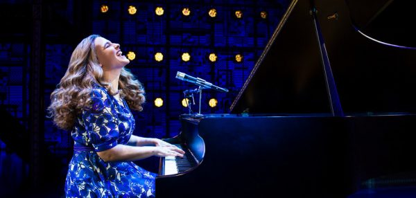 An actress plays piano in Beautiful- The Carole King Musical