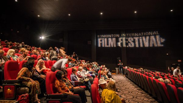 People watching a film at the Edmonton International Film Festival