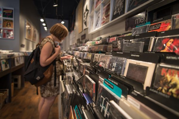 Women browsing the racks of CDs at Blackbird Music.
