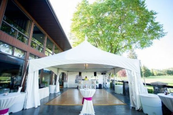 A white tent in front of the country club