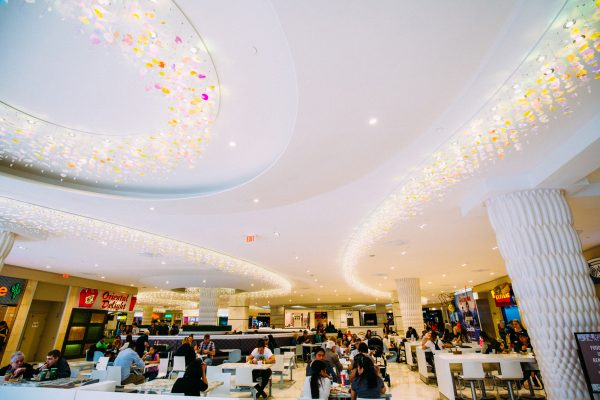 People eating in one of the food courts at West Edmonton Mall
