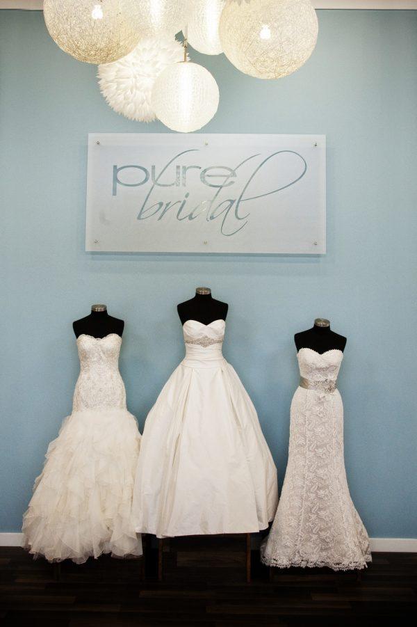three wedding dresses on mannequins at pure bridal