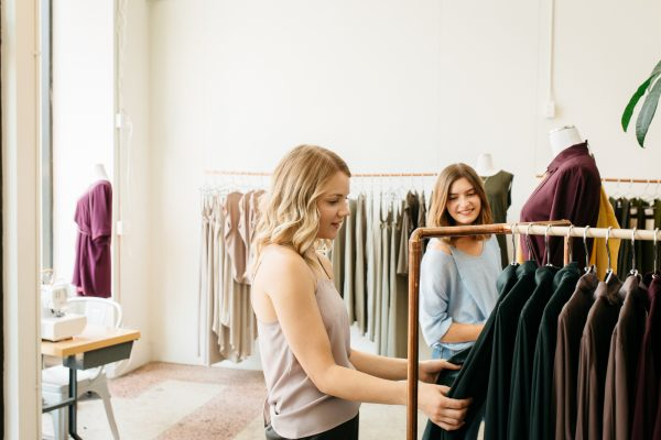 Two women looking clothing at Workhall boutique.
