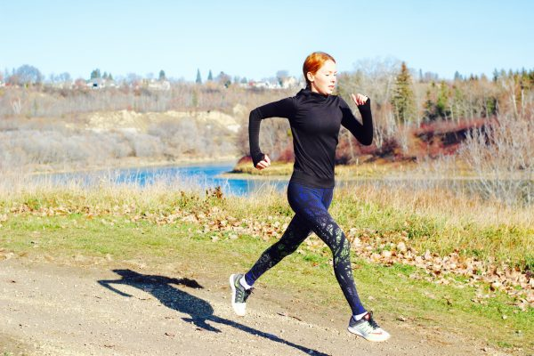 Melissa Hetu runs along the banks of the North Saskatchewan River.