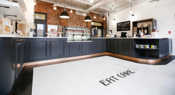 """sugared and spice interior shot of the floor that says """"eat cake"""""""
