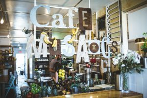 The sign and storefront at Cafe Mosaics.