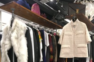 Coats on a clothing rack at Blogger Armoire boutique.