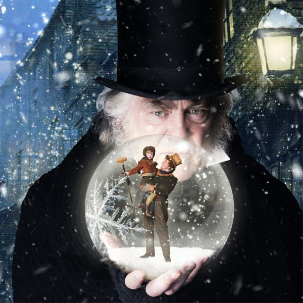 Ebenezer Scrooge holding a snowglobe that contains a vision of the future.